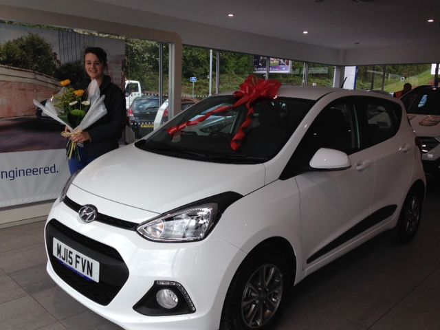 Miss Ashcroft collecting her brand new Hyundai i10 Premium on her 18th birthday from Dave Partington.