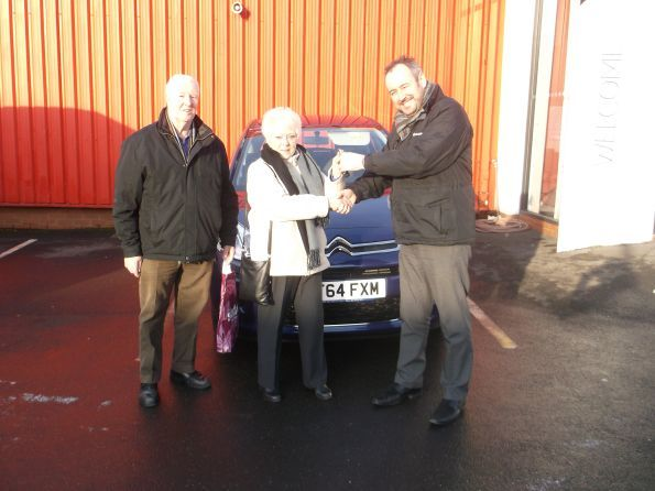 Miss Myrtle collecting her new car from Citroen Bury