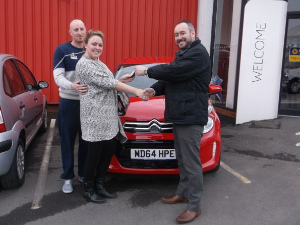 Miss Roscoe collecting her new C1 from Citroen Bury
