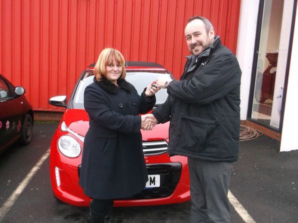 Miss Stewart collecting her new C1 from Lee Anslow at Citroen Bury