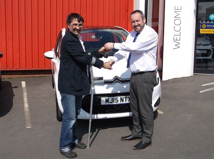 Mr Laight collecting his brand new Citroen C4 Picasso from Lee Anslow at Citroen Bury.