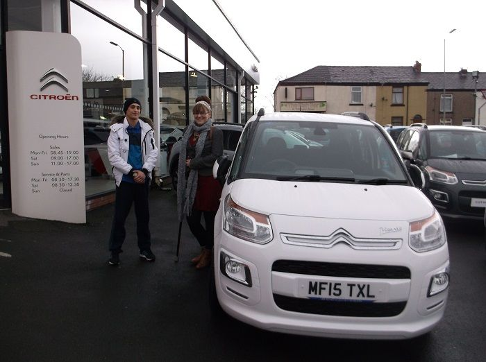 Miss Evans with her son collecting her 15 plate C3 Picasso from Lee Haworth at Bury.