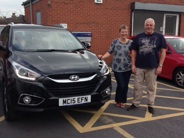 Karen and Glenn collecting their brand new ix35 from Dave Partington at Hyundai Bolton - Happy shopping!
